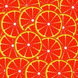 Red grapefruit. Overlapping slices of red grapefruit Royalty Free Stock Images