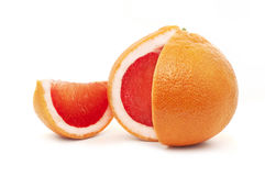 Red grapefruit. Grapefruit with the cut-out segment  isolated on wight background Royalty Free Stock Photos