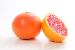 Red Grapefruit. Isolated on white glossy background Stock Photography