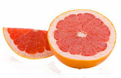 Red grapefruit. Half and a grapefruit segment isolated on a white background Stock Photography