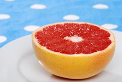 Red grapefruit closeup shallow DOF Royalty Free Stock Photo