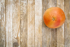 Red grapefruit on grunge wood Royalty Free Stock Photo