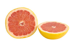 Red grapefruit halves. Two halves of red grapefruit on white background Royalty Free Stock Photography
