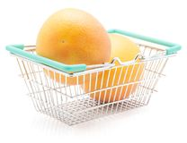 Red grapefruit isolated. Red grapefruits in a shopping basket isolated on white background two whole Royalty Free Stock Photos