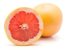 Red grapefruit isolated. One red grapefruit ring slice and one whole isolated on white background Stock Photography