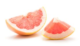 Red grapefruit isolated. One red grapefruit slice and a piece isolated on white background Royalty Free Stock Photography
