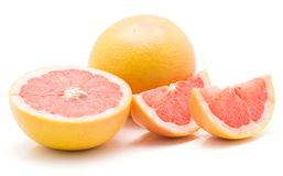 Red grapefruit isolated. On white background one whole one cross section half and two slices Royalty Free Stock Image