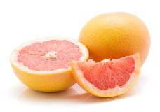 Red grapefruit isolated. On white background one whole one half and a slice Stock Images