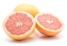 Red grapefruit isolated. On white background one whole and two cross section halves Stock Photo