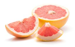 Red grapefruit isolated. Sliced red grapefruit isolated on white background comparing one half cross section one slice and one piece Royalty Free Stock Images