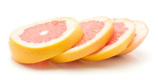 Red grapefruit isolated. Sliced red grapefruit isolated on white background four rings Royalty Free Stock Photo
