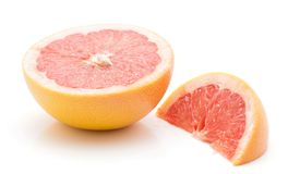 Red grapefruit isolated. Sliced red grapefruit isolated on white background one half and a slice Royalty Free Stock Photos