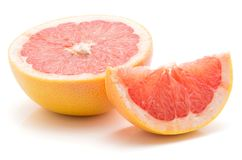 Red grapefruit isolated. Sliced red grapefruit isolated on white background one half one slice Stock Photos