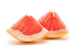 Red grapefruit isolated. Two red grapefruit pieces isolated on white background Stock Photos