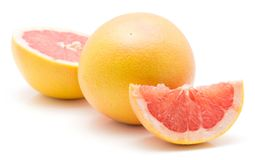 Red grapefruit isolated. On white background one whole half and slice Stock Photography