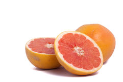 Red grapefruit one whole and two half isolated on white background. Grapefruit one whole and two half isolated on white background royalty free stock photo