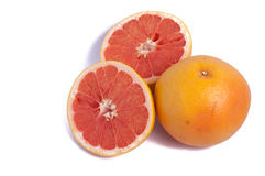 Red grapefruit one whole and two half isolated on white background. Top view royalty free stock images