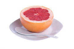 Red grapefruit on a plate Stock Image