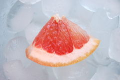 Red grapefruit on rocks Royalty Free Stock Photos