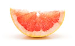 Red grapefruit isolated. Red grapefruit slice isolated on white background Royalty Free Stock Photo