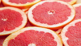 Red grapefruit slices, motion backgrounds Royalty Free Stock Photos
