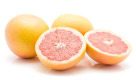 Red grapefruit isolated. Red grapefruits isolated on white background two whole one cut in half cross section Stock Images