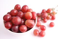 Red grapes. On white background Royalty Free Stock Photo