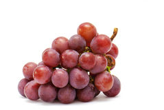 Red grapes. Fresh red grapes on white background Royalty Free Stock Image