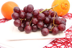 Red grapes. Some fresh red grapes on a plate royalty free stock photography
