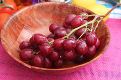 Red Grapes. Some fresh red grapes in a bowl royalty free stock photo
