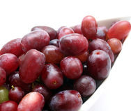 Red grapes. Some fresh red grapes in a bowl stock images