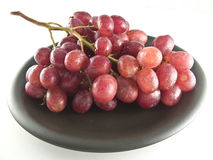 Red grapes. Fresh red grapes isolated on white background Royalty Free Stock Photography