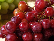 Red Grapes. Green grapes in background stock photos