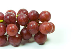 Red grapes. Large bunch of ripe green and red juicy seedless grapes Stock Images