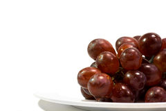 Red Grapes. Wet red grapes on top of a ple )with lots of copy space Royalty Free Stock Image