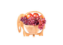 Red Grapes and Apples in wooden basket Royalty Free Stock Photography