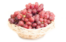 Red grapes in basket Royalty Free Stock Image