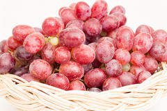 Red grapes in basket Royalty Free Stock Photography