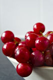 Red Grapes at Bowl Edge Royalty Free Stock Photography