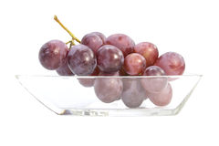 Red grapes bunch fresh fruit on glass plate Royalty Free Stock Photos