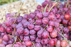 Red grapes bunches on farmer market Royalty Free Stock Image