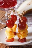Red grapes and cheese on skewers close-up vertical Stock Photos
