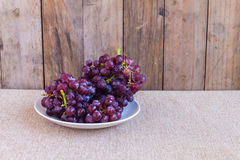 Red grapes on dish Royalty Free Stock Photo