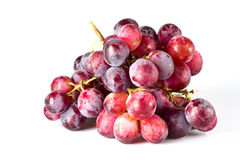 Red grapes. Fresh red grapes on white background Royalty Free Stock Photo