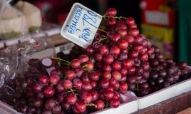Red grapes in fruit store. Red grapes sell at fruit store in Chiang Mai Stock Image