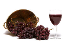 Red grapes and a glass of wine Stock Photography