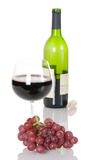Red Grapes With Glass Of Wine And Bottle Stock Images