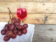 Red grapes with grape juice. stock photos