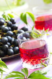 Red grapes and grape juice Royalty Free Stock Photography