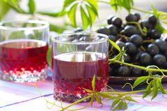 Red grapes and grape juice Royalty Free Stock Photo